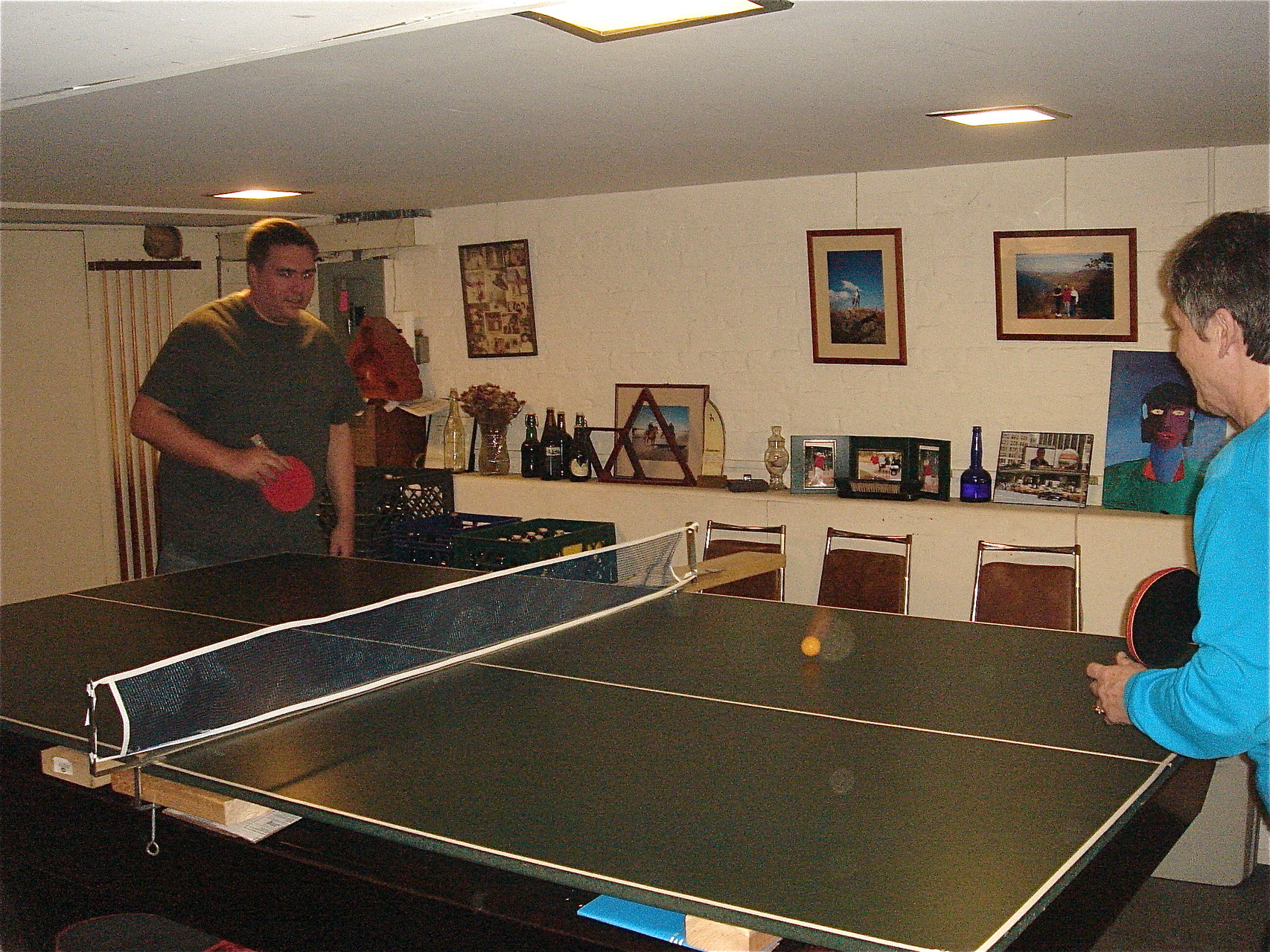 Greg plays ping pong with his Aunt,  Cindy Wagner