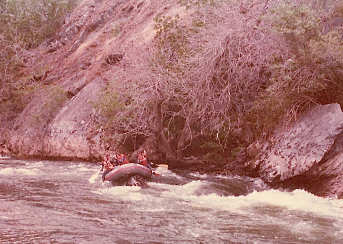Lab raft caught on rock, Stanislaus River, April 1977