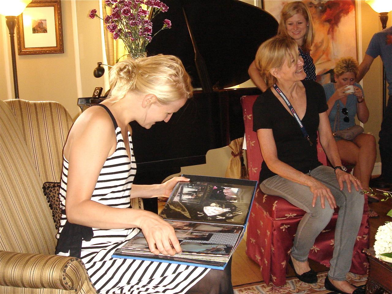 Sarah looks at her scrapbook