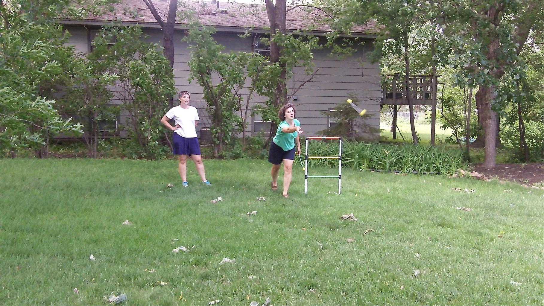 Cindy looks on as Ann throws