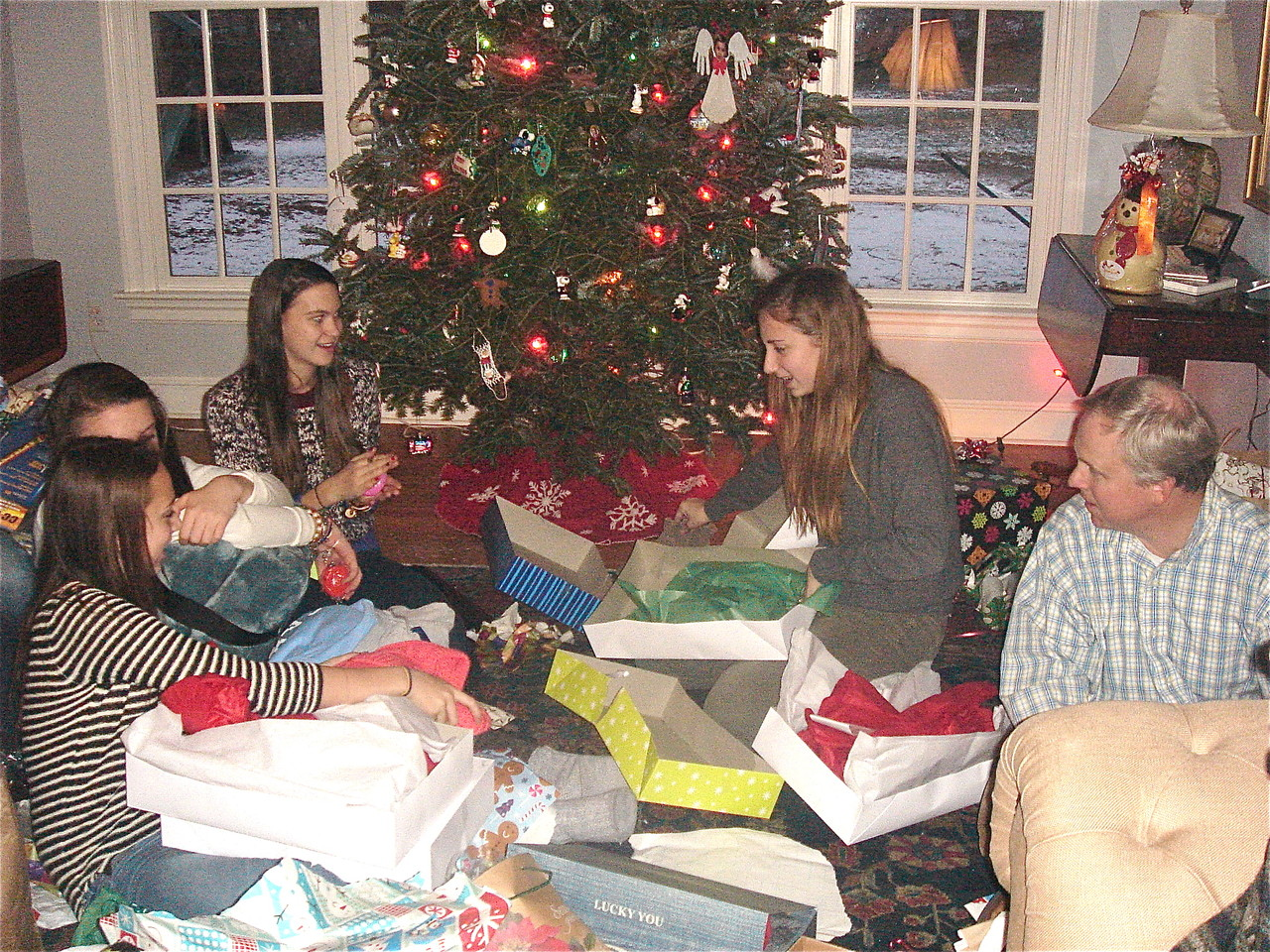 Xmas Day, Kagel family home in Conn., Gabby, Kate, Ellie & Emma open presents while Stuart Jr. looks on