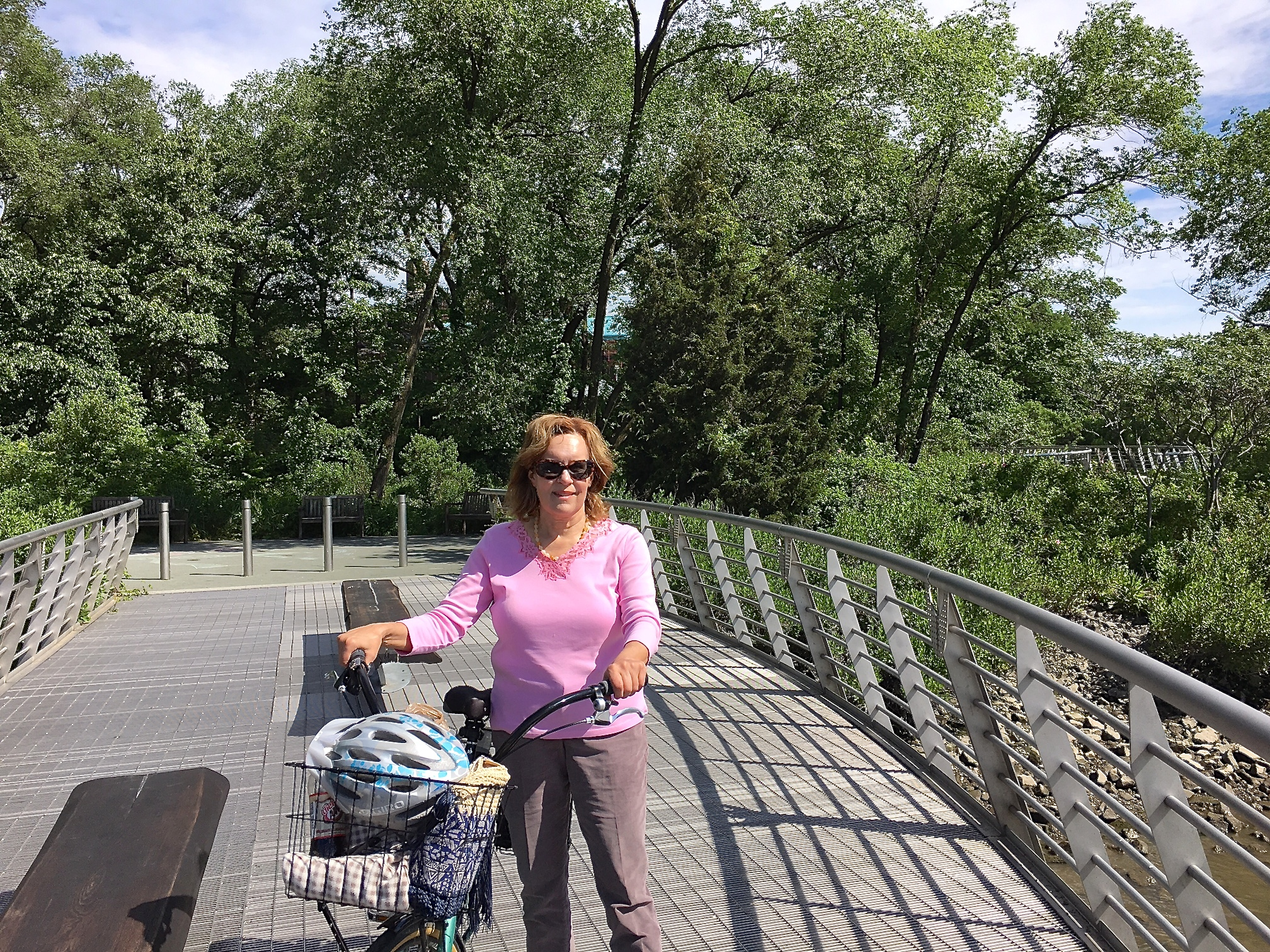 Lorraine Gudas biking along the Harlem River, 6-4-17