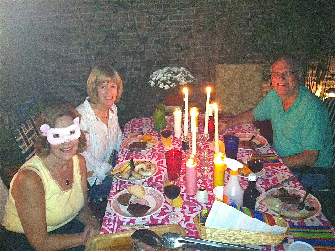Steak dinner, Oct. 3, 2013, Lorraine in pig mask, Nancy, & Bernd..Thanks, Anna and Patrick!
