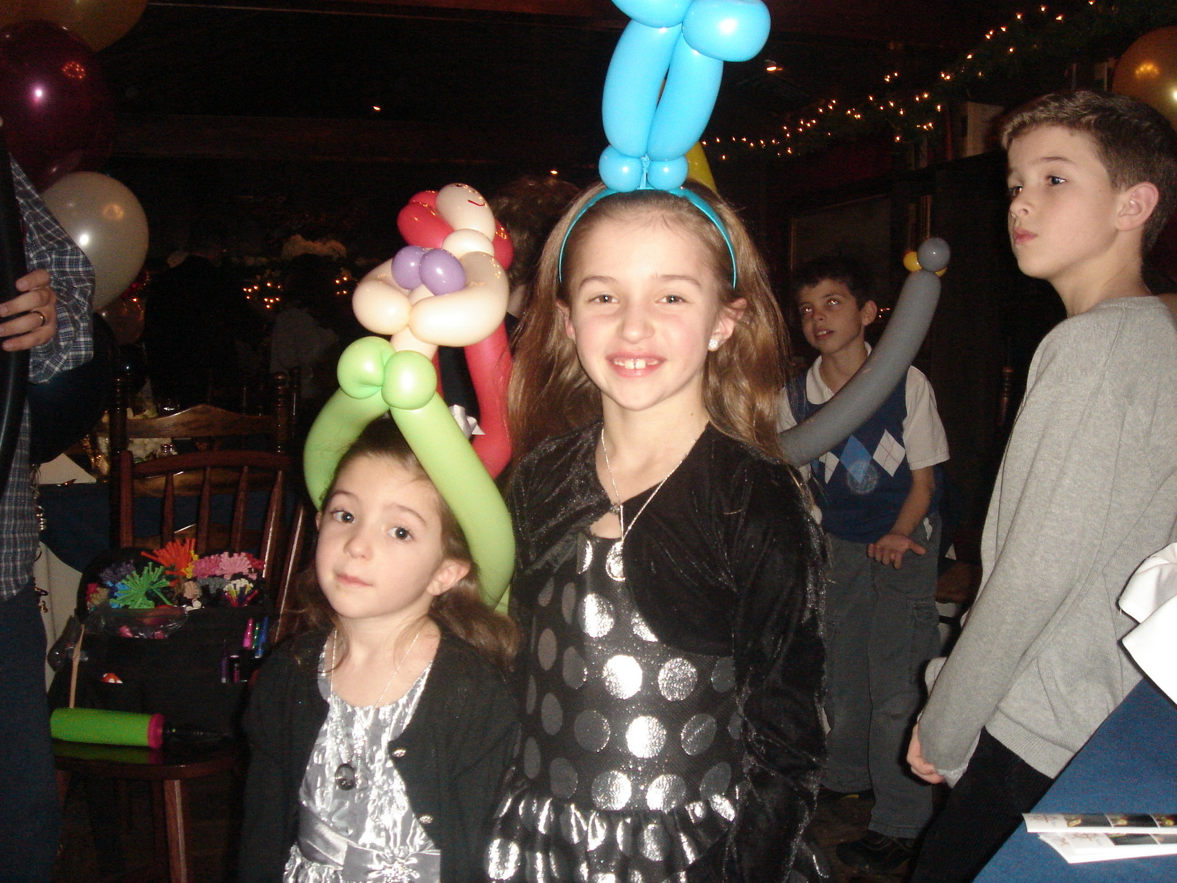 The children enjoyed the balloons! Little Mermaid headdress on left....