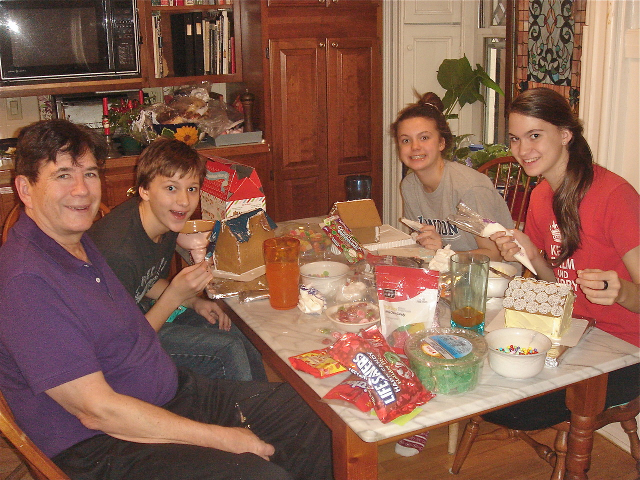 John, Jack, Kate, & Ellie make gingerbread houses.