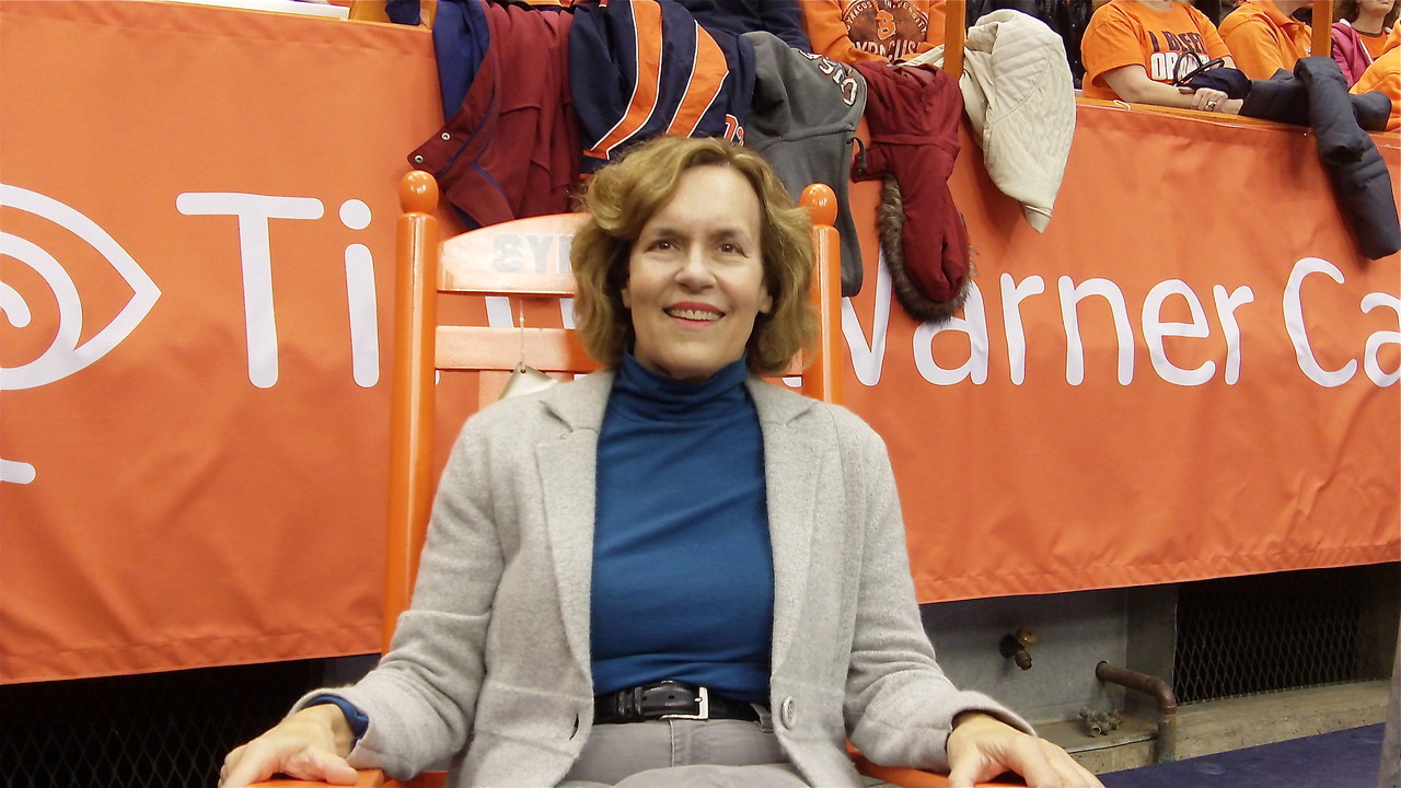 Lorraine in a big, orange SU chair.