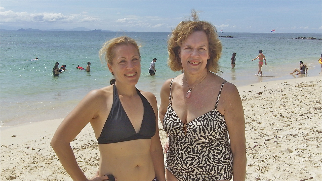 Emily & Lorraine catch up on family news on the beach...Sabah, Malaysia, Borneo