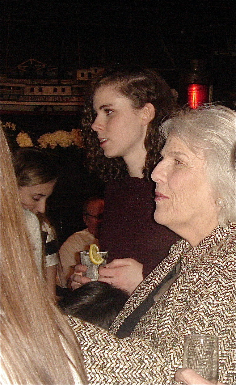 Erin Kagel and her grandmother Jane Kagel watch the roast.