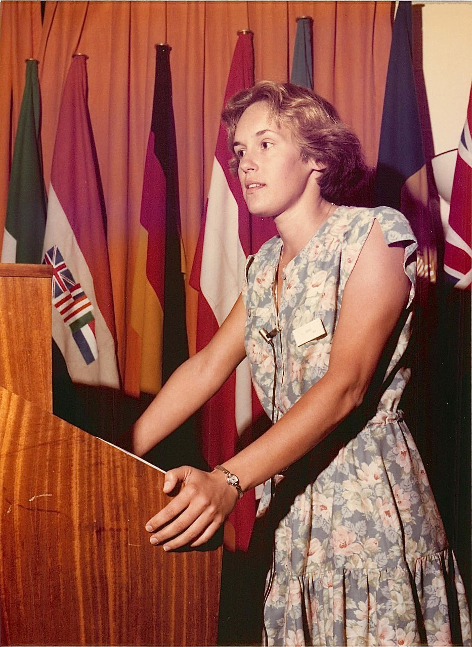 Lorraine Gudas, 1979, giving a talk at an internat'l science meeting in Madrid