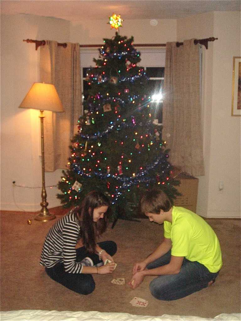 Ellie & Jack play cards in front of the Gudas Xmas tree in Syracuse.