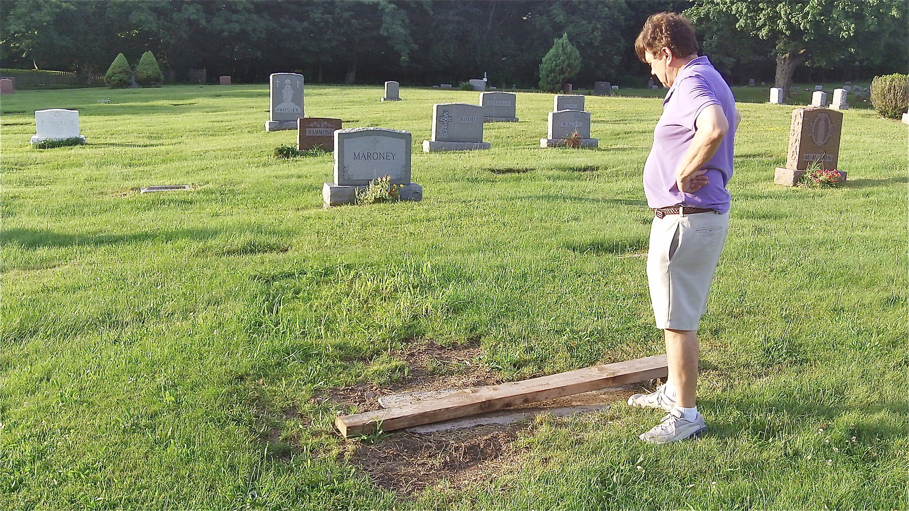 John & Lorraine check Al's grave-cement foundation for the stone has been layed.  7-13-14
