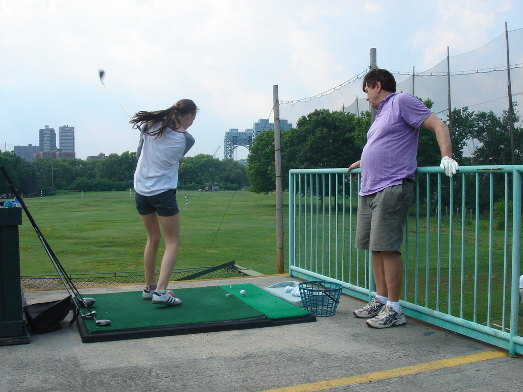 Ellie gets a golf lesson from John