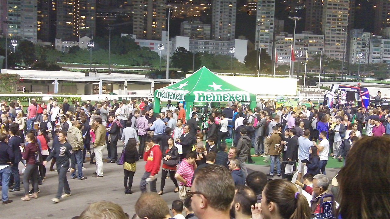 Happy Valley Race Track, HK, John & Greg in front talking to friends