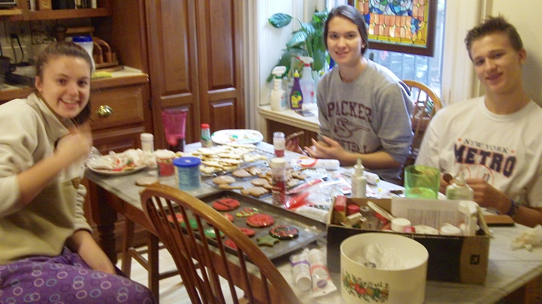 Kate, Ellie and Jack Kagel decorating cookies..