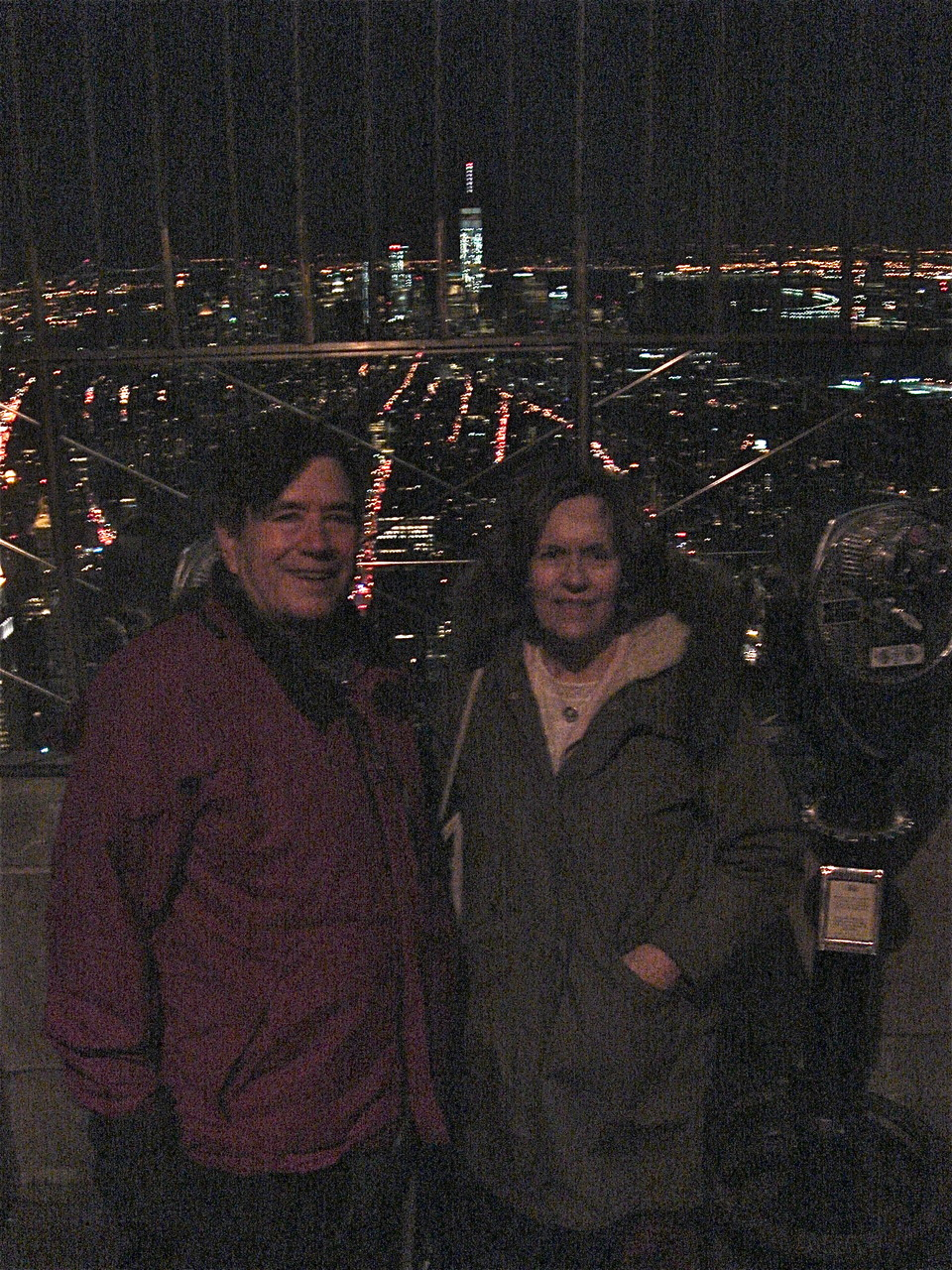 John and Lorraine, 2-28-15 looking south from the Empire State, Freedom Tower in bkground Building