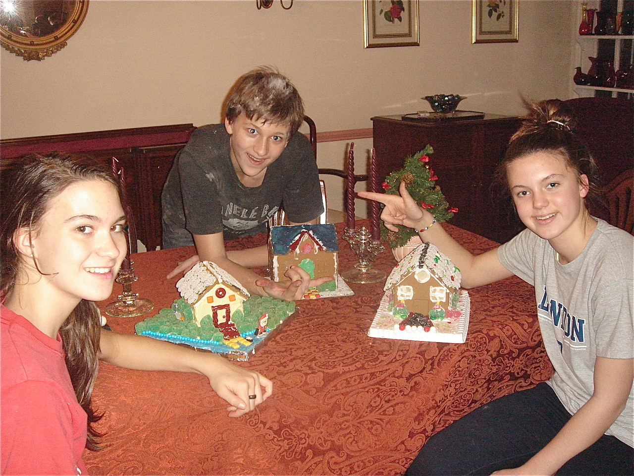 Ellie, Jack & Kate with their gingerbread houses. Ellie's is modeled after the Skaneateles lake house.