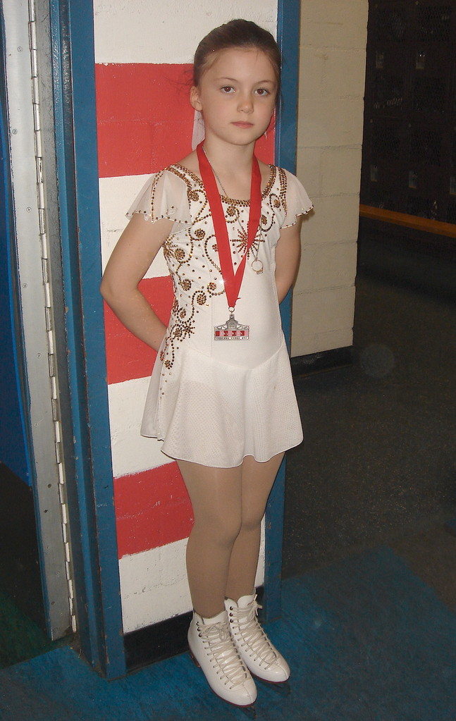 Kate wins a medal skating