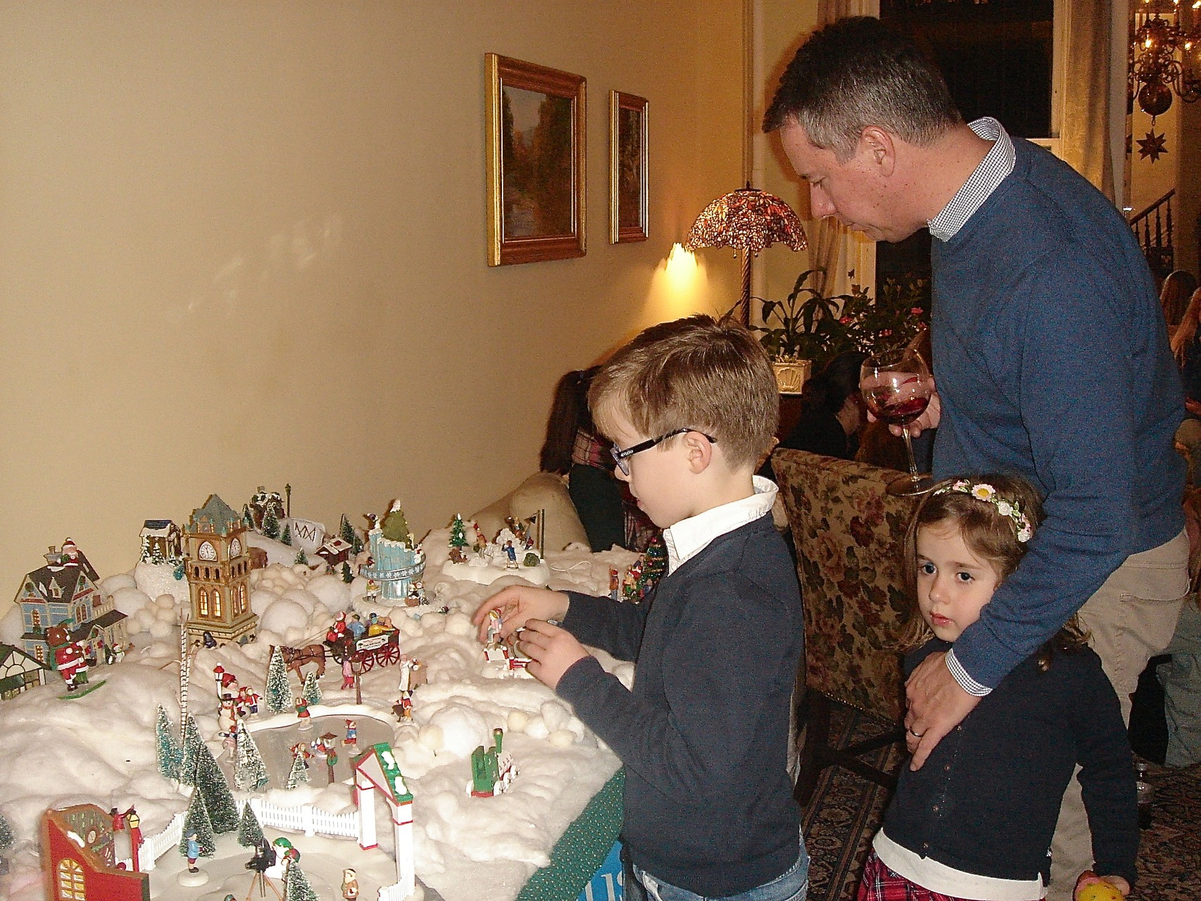 Jon Boylan with children Alexandre and Charlotte look at the Xmas village