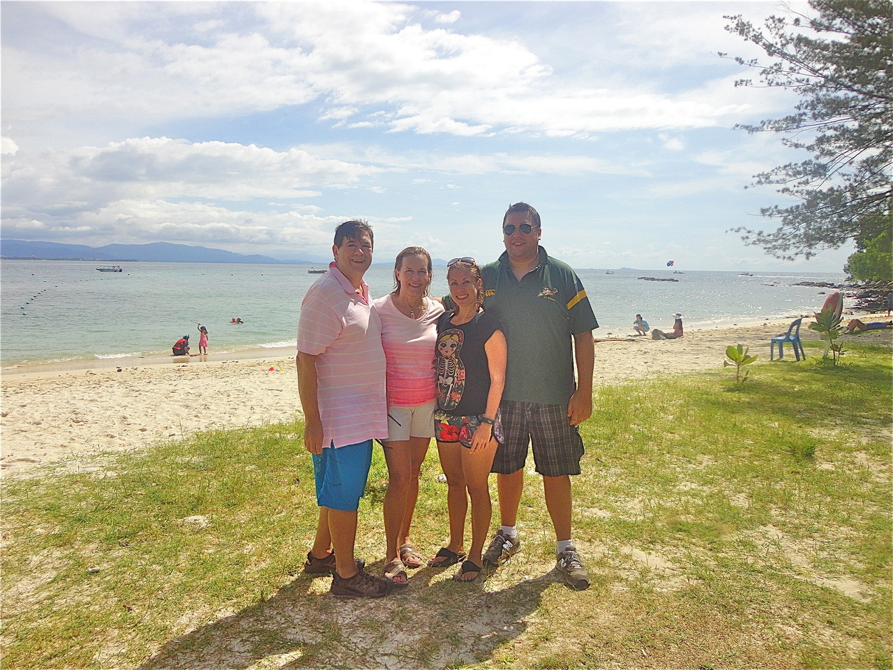John, Lorraine, Emily, & Greg on the beach, Mamutik island, one of the 3 islands in the Tunku Abdul Rahman Park.