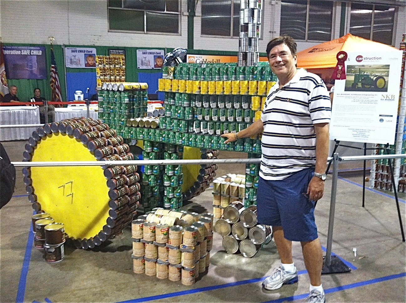 John with tractor made of cans