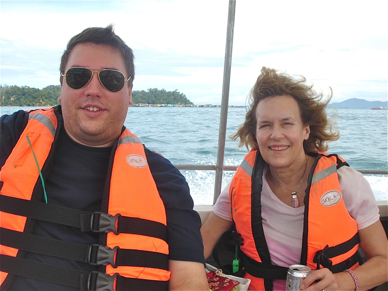 Greg & Lorraine on boat to snorkel at Mamutik island, one of the 3 islands in the Tunku Abdul Rahman Park.