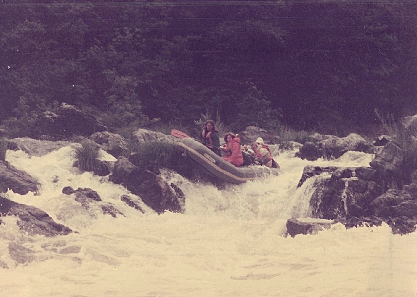 Steve & Lorraine are jolted forward as raft gets stuck on a rock...