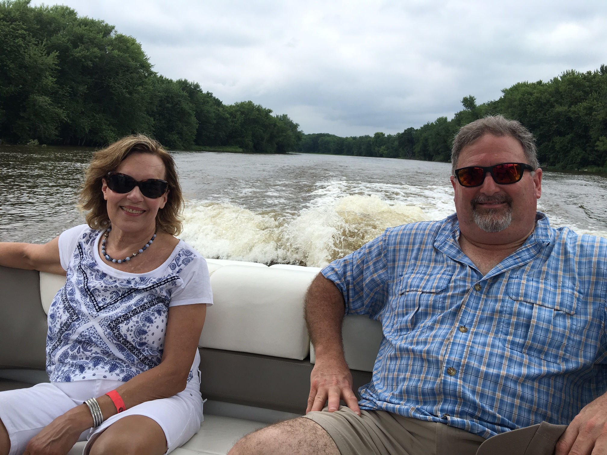 Lorraine Gudas and Keith Elinson enjoy the view from the back of the boat.