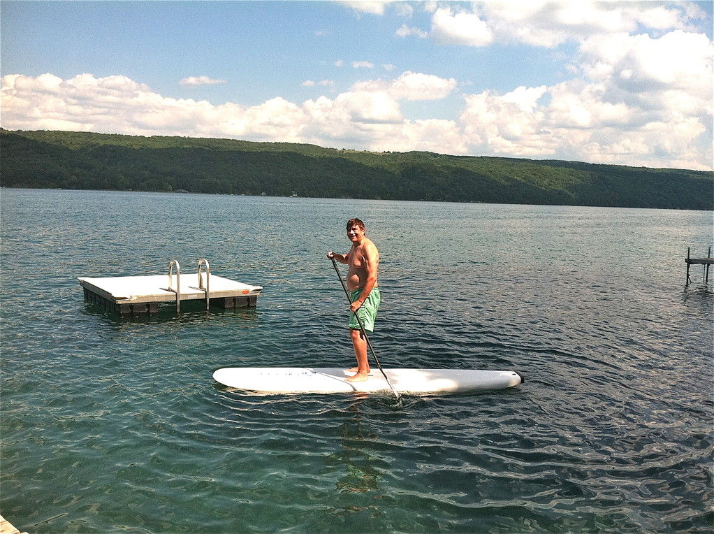 John paddleboards!
