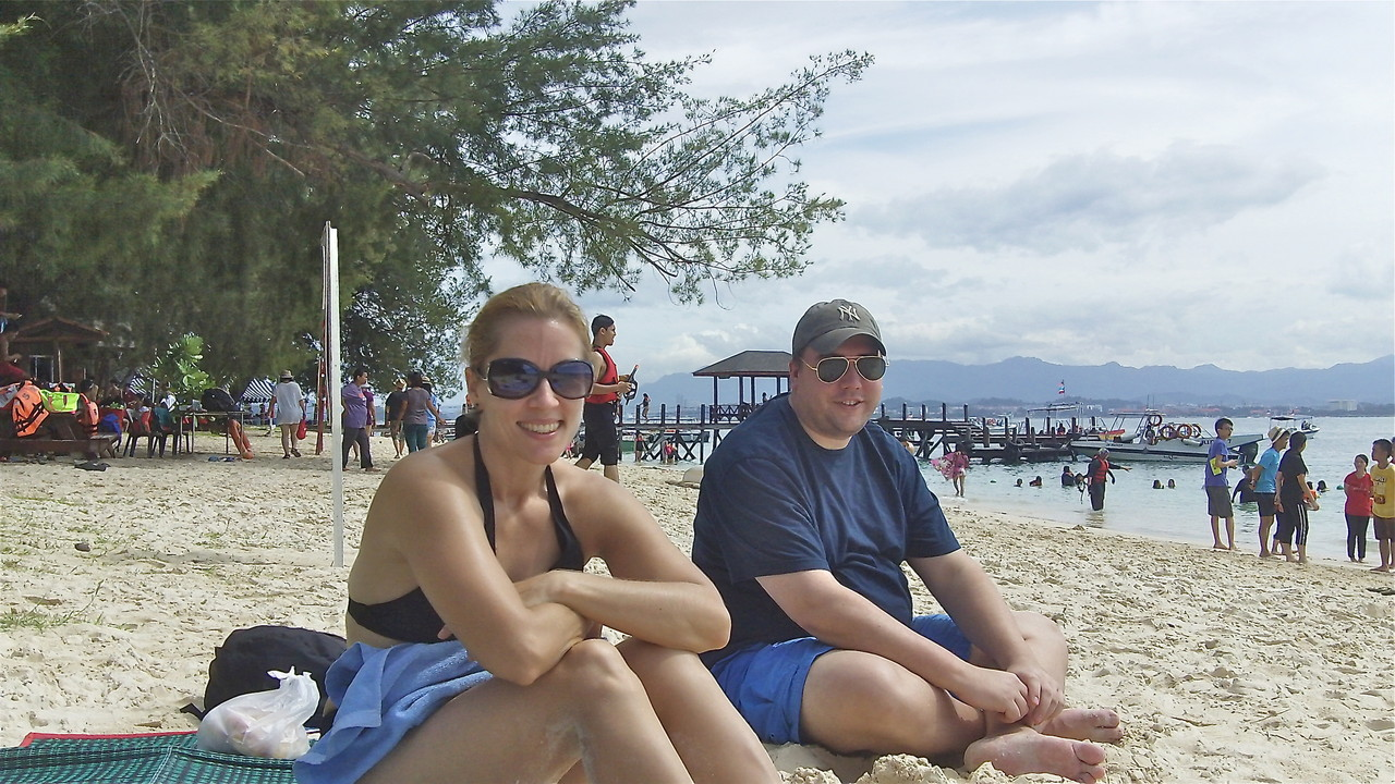 Emily & Greg relax on the beach.