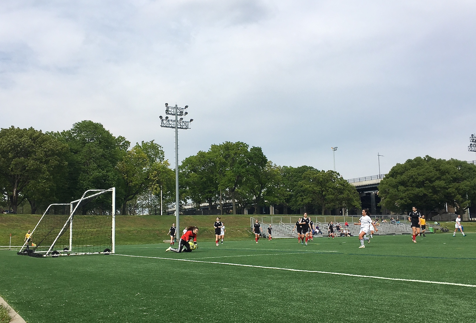 Kate  playing goalie, May 14, 2016 Randall's Island, in red jacket
