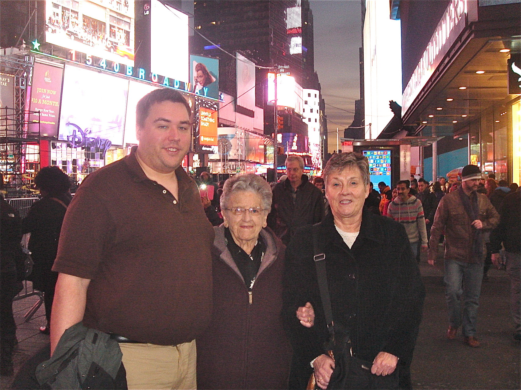 "Greg, Mary Lou, and Cindy Wagner in Times Square after seeing the musical ""MOTOWN"""