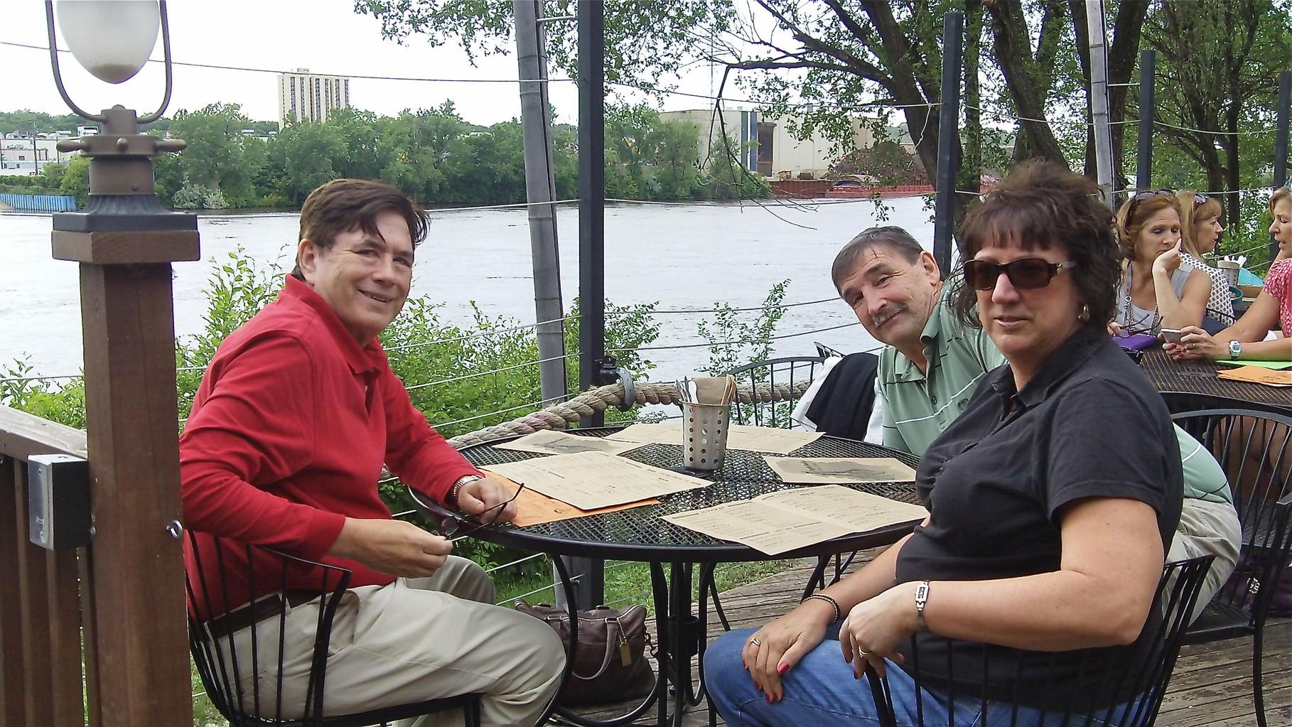 John, Paul & Jill Wagner at Psycho Suzi's Pizza along the Mississippi