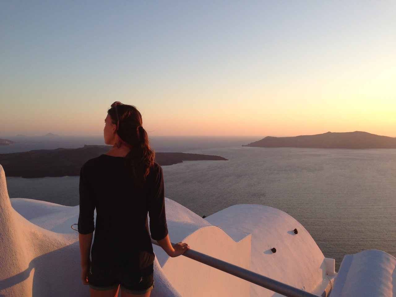 Ellie looks toward Santorini