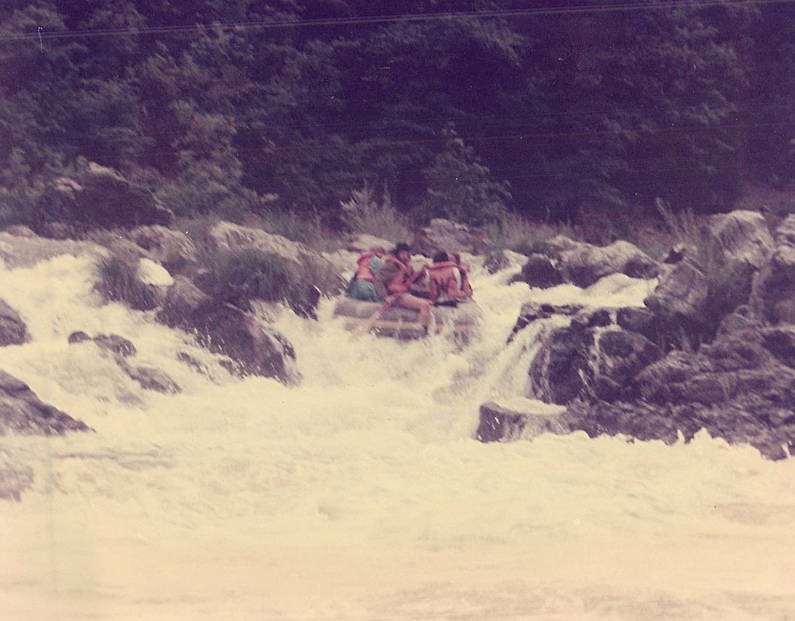 Reg Kelly, raft leader, guides his raft down backwards over Rainie Falls