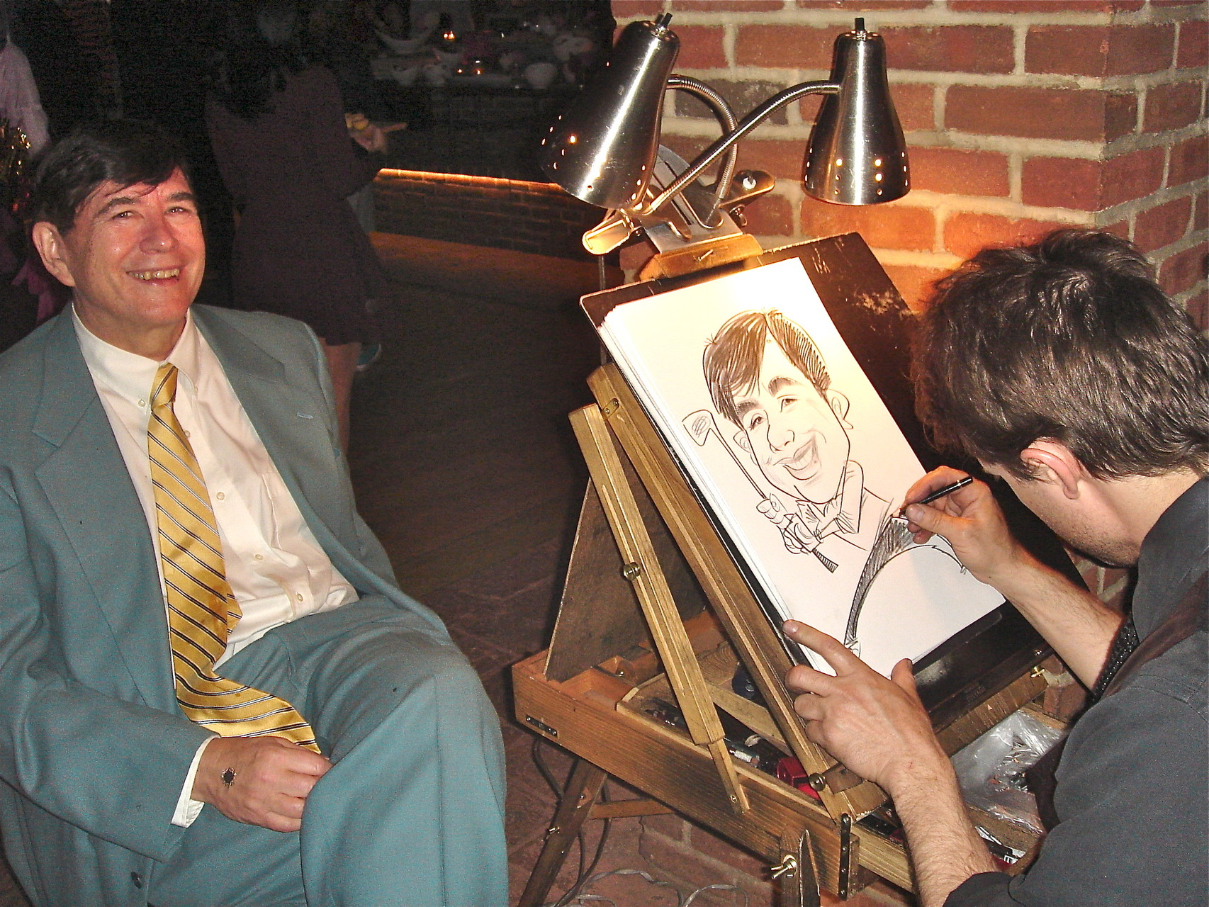 John gets a characature drawn