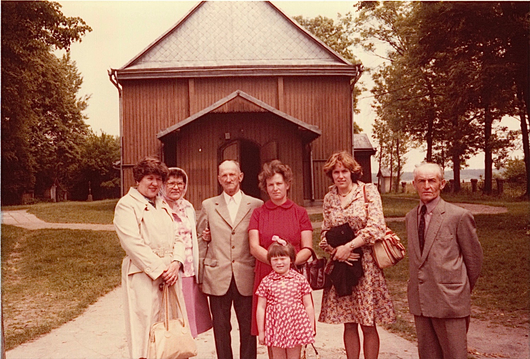 Eleanor, Mayme, a friend, Jadwiga with Irena, Lorraine, & Peter Bogdan in front of church where Paul bogden was baptized