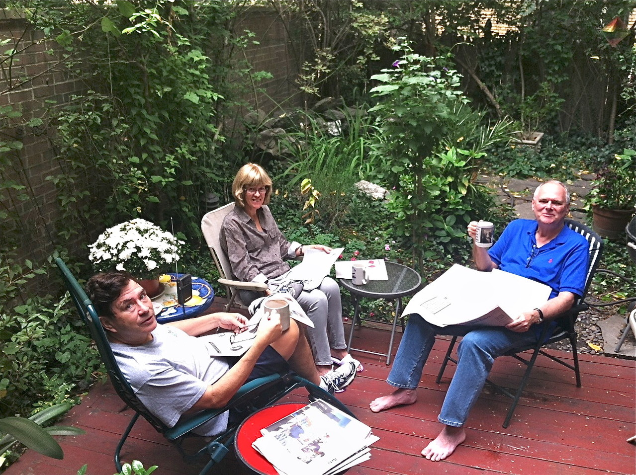 John, Nancy, & Bernd relax in our backyard.