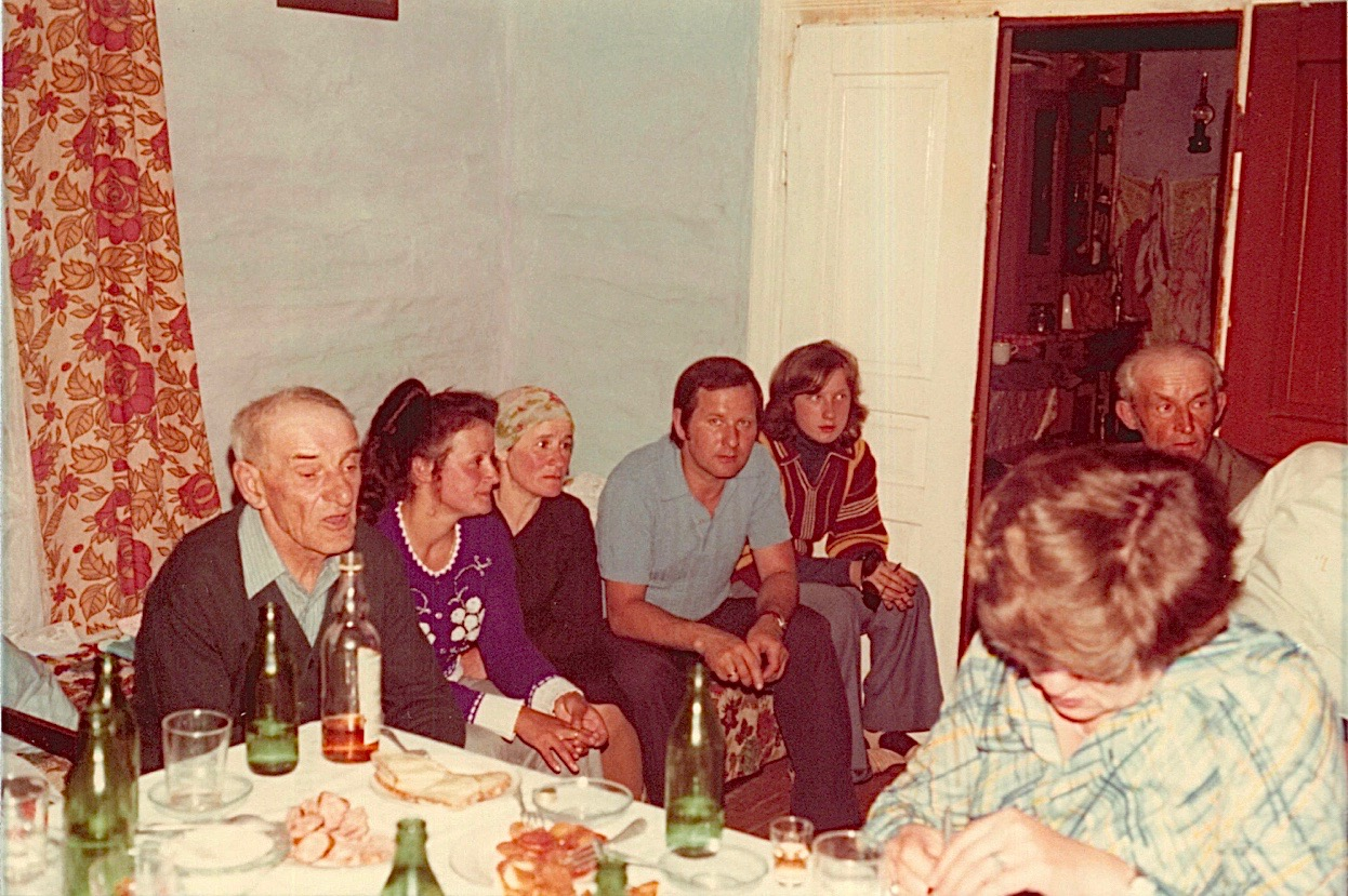 Inside Walter's home. Walter;Halina (this Halina is Halina Ziomek (20 yrs), daughter of Zofia Bogdan (Anna's daughter) & Ludwig Ziomek;Julia?;Stanley,Walter's son; Helina, Peter's daughter; & Peter?,Anna's son.  Eleanor is writing in front at the table.