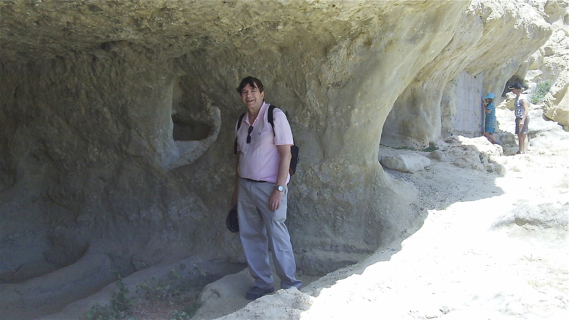 John on the Matala cliffs and caves; you can see the Roman grave sites delineated in the cave.