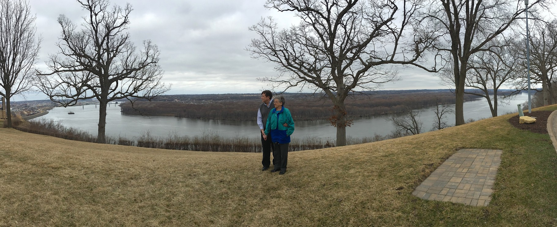 John & Mary Lou, downtown Dubuque in background on left, Mississippi River March, 2016