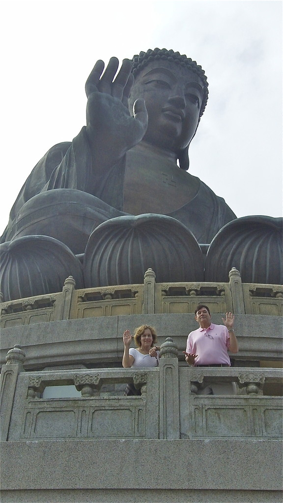 Lorraine & John with the Big Buddha, in Buddha poses...