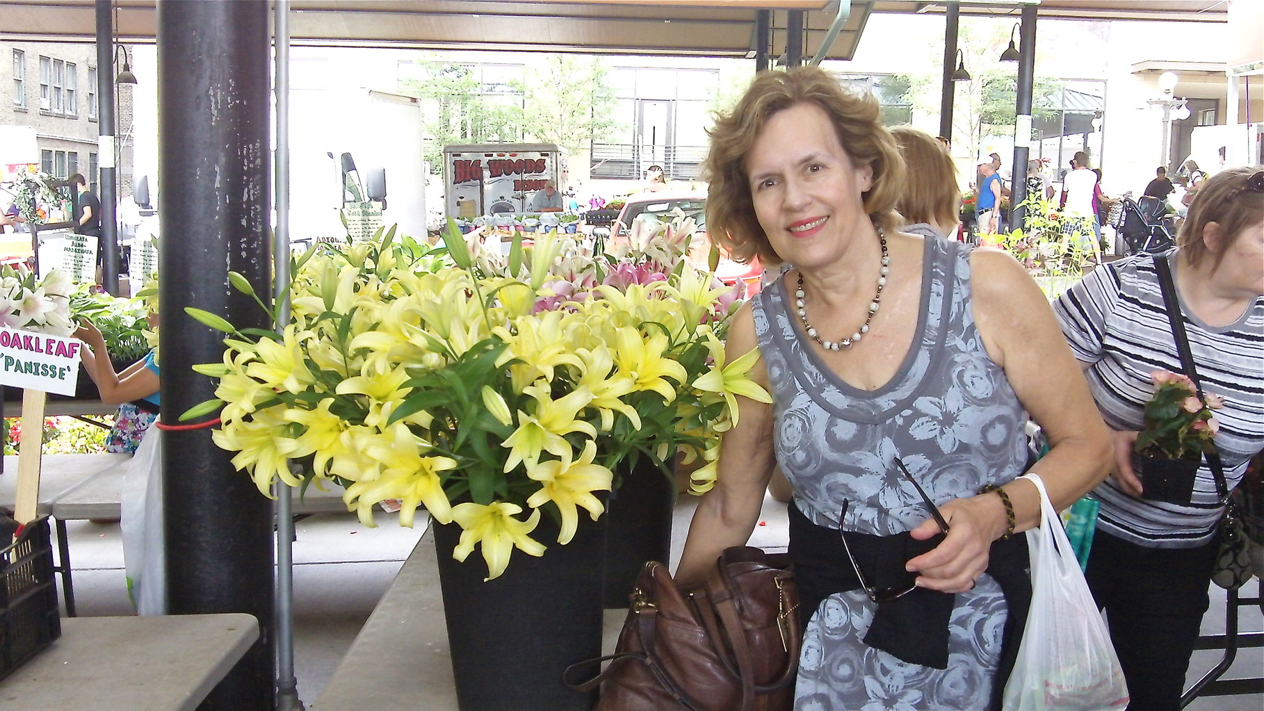 Lorraine Gudas admires the lillies at the Farmer's Market