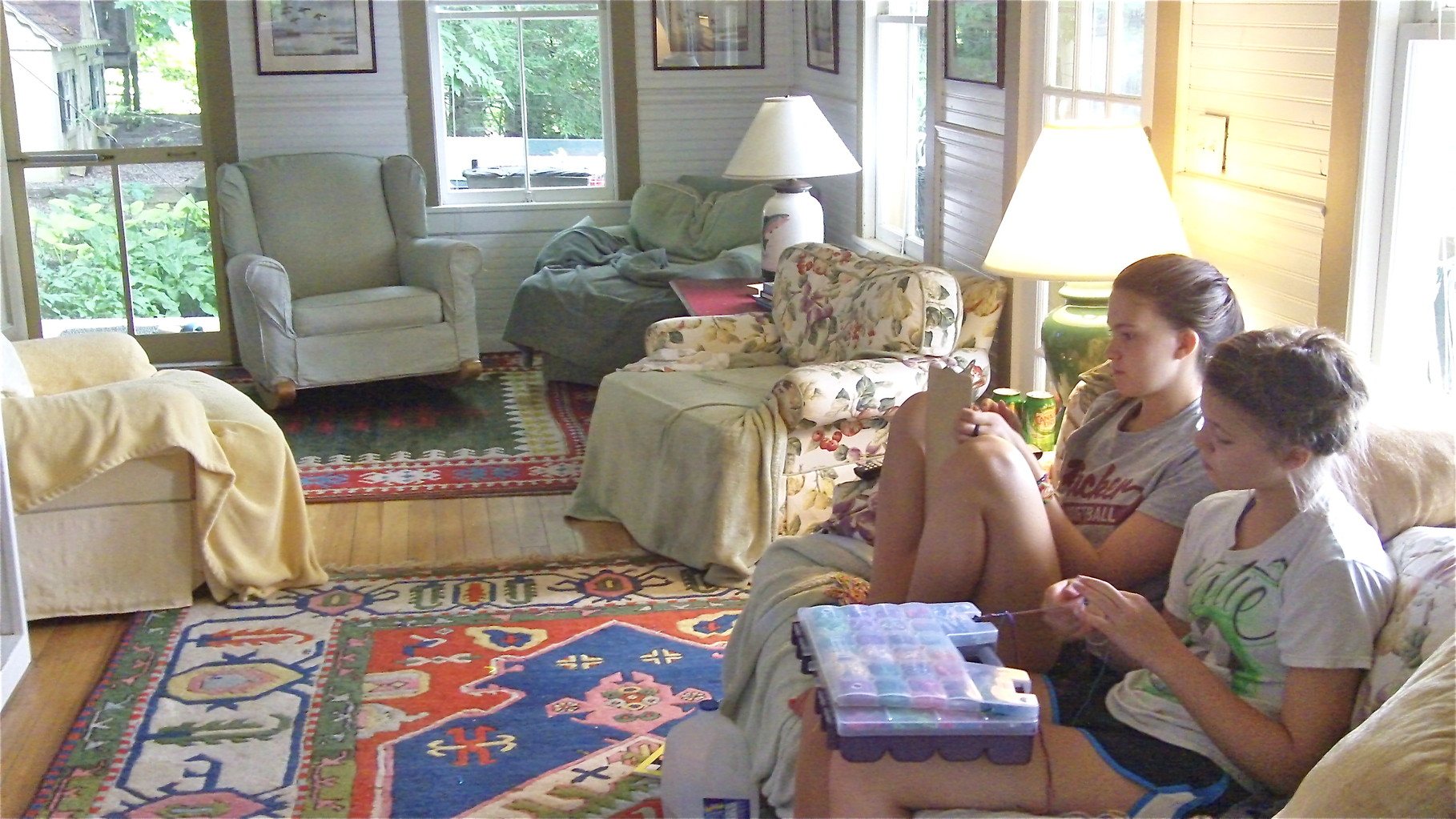 The girls make bracelets on a rainy day in July, 2014, at the lakehouse.