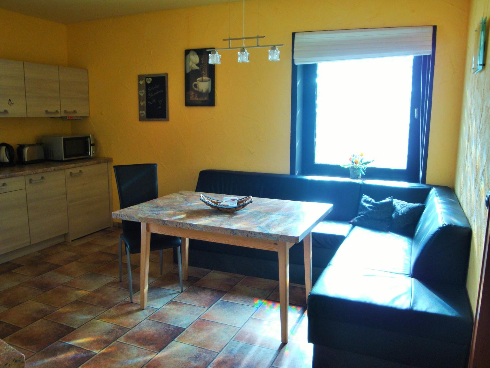 OG App. Wohnküche Sitzecke
