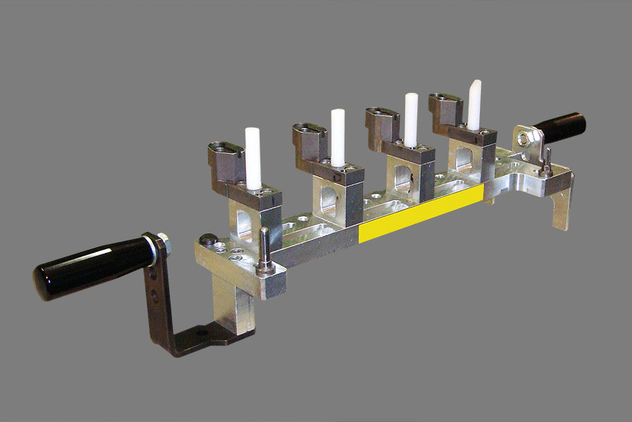 Workpiece insertion system for oil spray nozzle