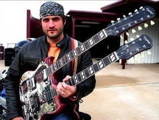 "Robert Rodriguez with George Yepes Signature Custom Double-Neck ""Shotgun Messenger"" Gibson guitar."