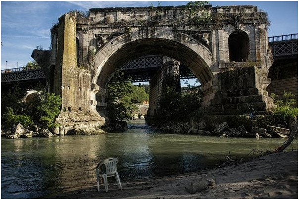 A section of Tiberina Island in Rome, the only island in the Tiber River. The river's filthy waterfront and murky waters are a painful reflection of the widespread neglect and degeneration that has blemished Rome's beauty.  (Nadia Shira Cohen for The New