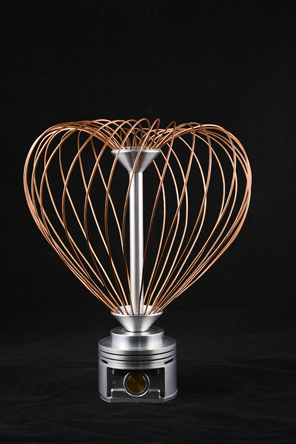 "SculptureRotating Heart Sculpture, 13"" height x 9"" diameter, aluminium and copper, 2012."