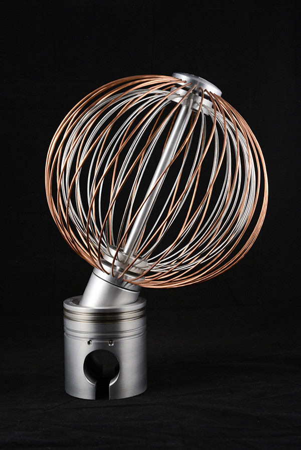 "Rotating ""Imagine"" Sculpture, 18"" height x 13"" diameter, aluminium and copper, awarded honorable mention at the Art Contest  Marius Barbeau Museum, 2011."