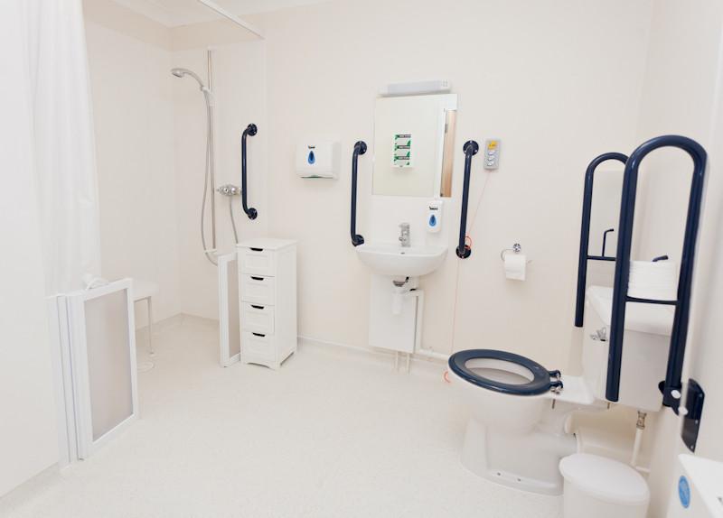 Bathroom with Arjo automated bath